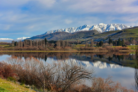 Scenic Lake Hayes and surrounding mountain ranges