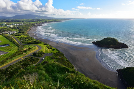 Aerial view of New Plymouth and the coastline from Paritutu Rock in New Plymouth, New Zealand