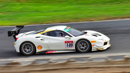 HAMPTON DOWNS, NEW ZEALAND - APRIL 18: David Dicker racing in a Ferrari 488 Challenge at Ferrari Challenge Asia Pacific Series race on April 15, 2018 in Hampton Downs Editorial