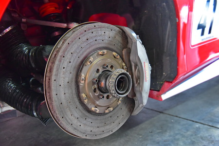 HAMPTON DOWNS, NEW ZEALAND - APRIL 18: Carbon ceramic brake disc of a Ferrari 488 Challenge car at Ferrari Challenge Asia Pacific Series race on April 15, 2018 in Hampton Downs Editorial