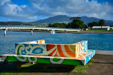 Colorful and vibrant bench at Raglan Beach in New Zealand