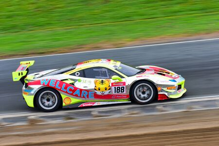 HAMPTON DOWNS, NEW ZEALAND - APRIL 18: Tiger Wu racing at Ferrari Challenge Asia Pacific Series race on April 15, 2018 in Hampton Downs Editorial