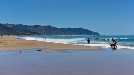 Golden sand Ocean Beach popular for recreational activities in Hastings, New Zealand Stock Photo