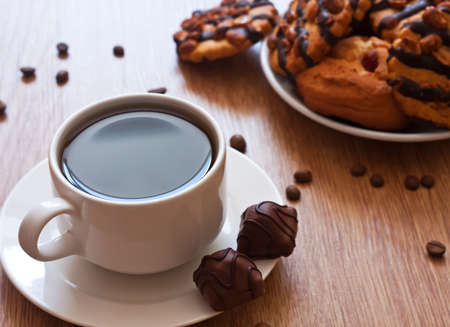 hot coffees: cup of coffee and chocolate cookies on wood table Stock Photo