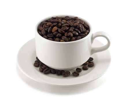 coffee beans in a cup on white background photo