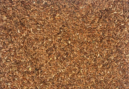 closeup of healthy omega 3 filled flax seeds background photo