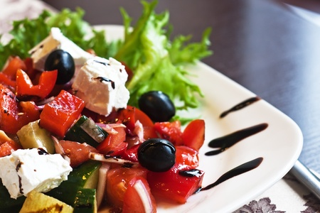 greek food: Greek Mediterranean salad with feta cheese, olives and peppers