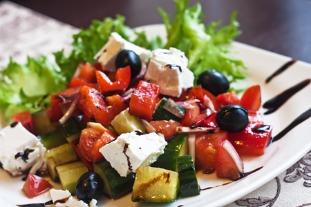 close up food: salad with feta cheese, olives and peppers