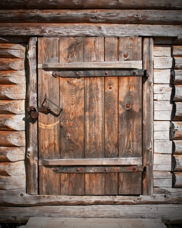 vintage brown wooden door in old barn photo