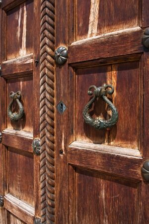 An image of vintage door handles on decorative doors   photo