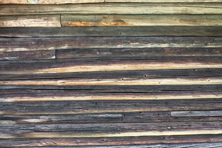 Structure of a wall from old wooden logs photo
