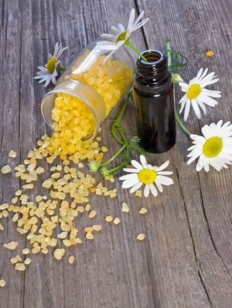 bowl of chamomile bath salt and essential oil Stock Photo - 10439241