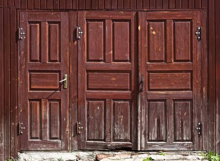 french doors: Detail large wooden doors of a old building Stock Photo