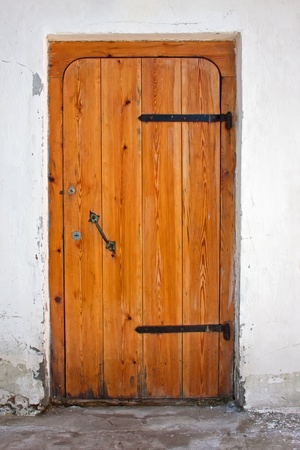 old wooden door in a cement wall  photo