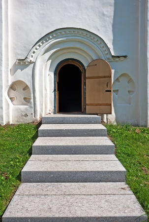 Arched medieval church door with stone lintel  photo