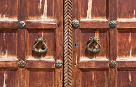 An image of vintage door handles on decorative doors Stock Photo - 10606614
