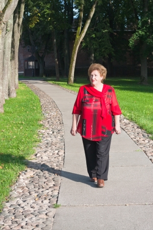 senior woman walking outdoors  photo