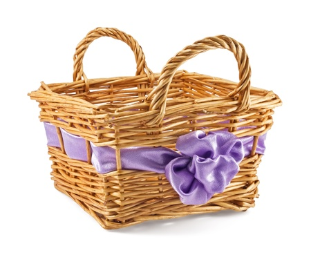 basket with a lilac bow isolated on white   photo