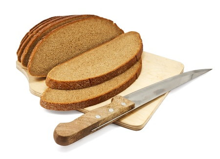 Sliced rye bread on a board with a knife isolated on white  photo