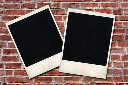 two photo frames against brick wall photo