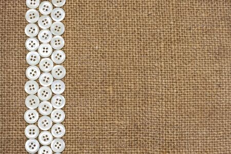 Nacre buttons on fabric texture background  photo