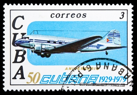 CUBA - CIRCA 1979: A stamp printed in Cuba, shows retro airplane on blue sky background, circa 1979  photo