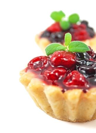 GELATIN: Fresh blackberry and raspberry cake on white background