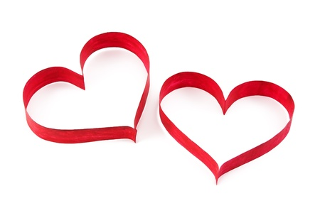 Paper red hearts on white background photo