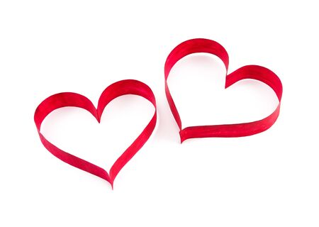 Paper red hearts on white background Stock Photo - 11936965
