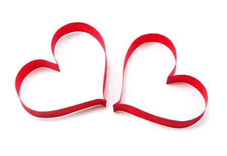 Paper red hearts on white background Stock Photo - 11936967