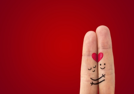 happy couple in love with painted smiley and hugging Stock Photo - 12534621