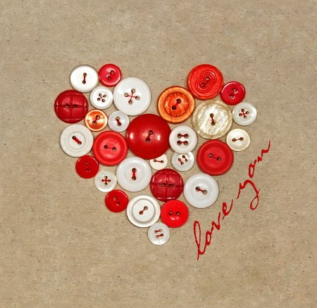 Old plastic buttons in a heart shape photo