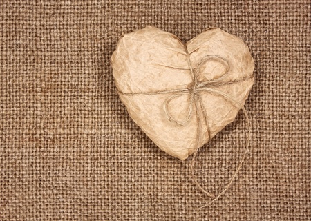paper heart on a burlap, as a  background photo