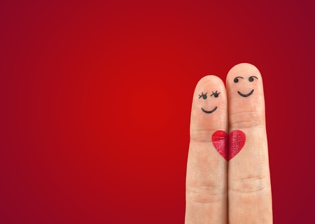 A happy couple in love with painted smiley and hugging Stock Photo - 12537883