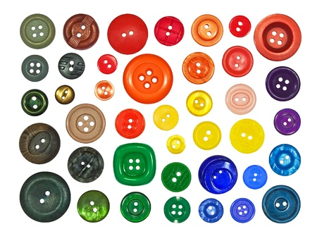 collection of various buttons on white background photo