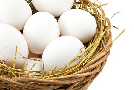 white eggs in the basket on white background  photo