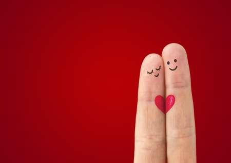 А happy couple in love with painted smiley and hugging Stock Photo - 12537953