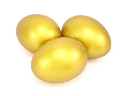 Three golden eggs isolated on white photo