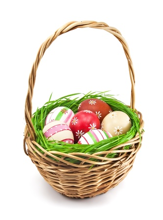 Easter eggs in the basket on white background photo