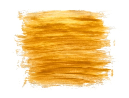 Gold acrylic paint brush strokes on white background photo