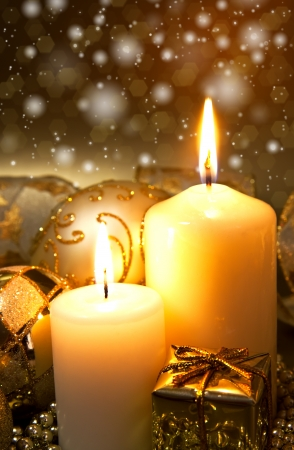 candlelight: Christmas decoration with candles over dark background Stock Photo