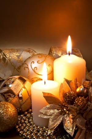 Christmas decoration with candles over dark background Stock Photo