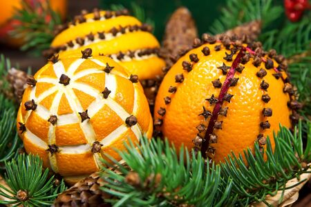 citrus tree: Christmas decoration with oranges in the basket and fir tree