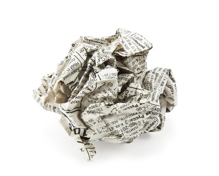 crumpled newspaper on a white background photo