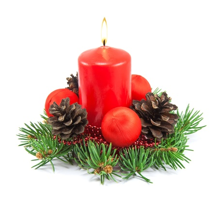 candle flame: Christmas decoration with red candle, pine cones, spruce branches on white background
