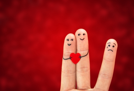 Happy couple in love, holds heart and third wheel Stock Photo - 17123198