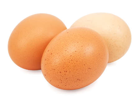Three yellow eggs on a white background Stock Photo - 17123202