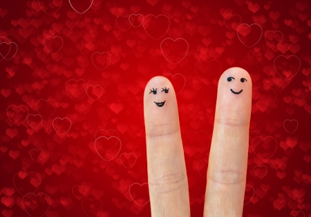 A happy couple in love with painted smiley Stock Photo - 17613474