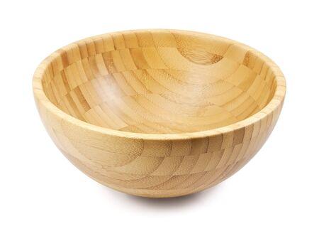 Wooden bowl on white background photo