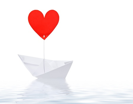 Paper ship with red heart sail on white background Stock Photo